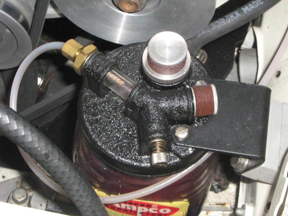 Closeup view of Ampco oiler attached to Judson supercharger
